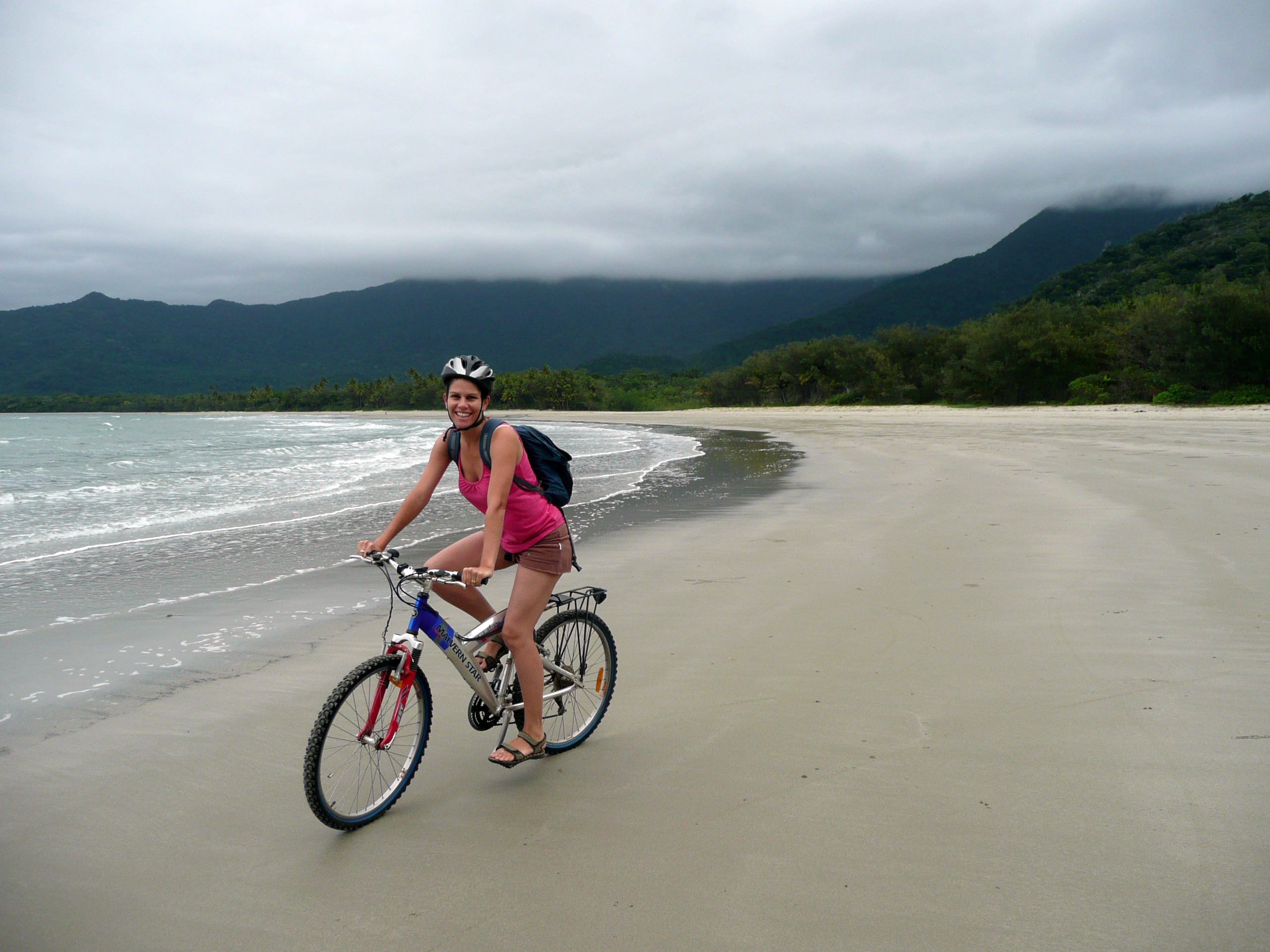Clare cycling along the beach at Cape Tribulation