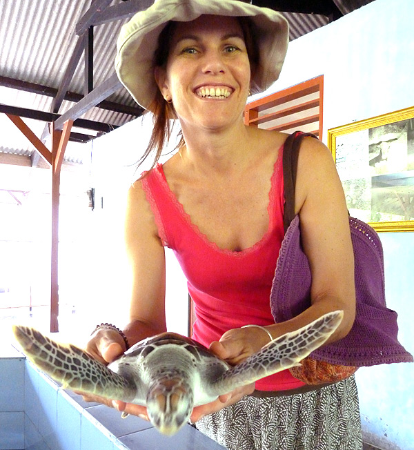 Brave Clare holding a turtle