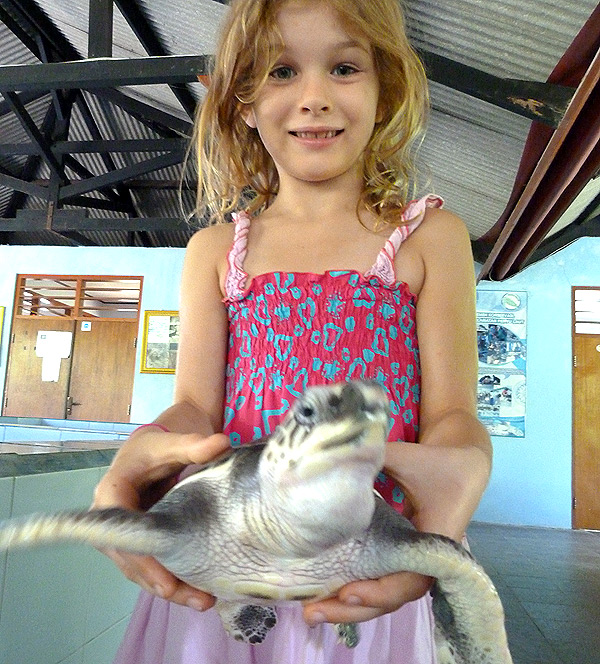 Olive holding a flapping turtle