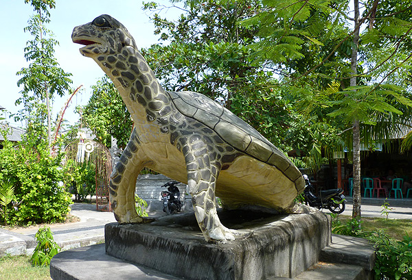 A giant turtle is there to greet  you.