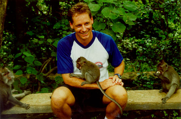Rob posing with a baby monkey at the Ubud Sacred Monkey Forest