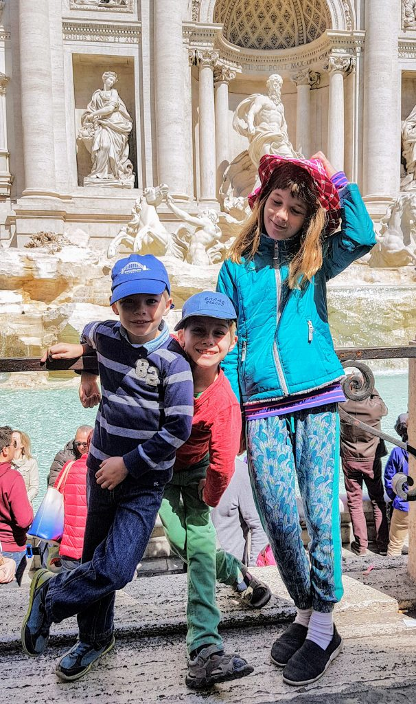 Throwing a coin in the Trevi fountain