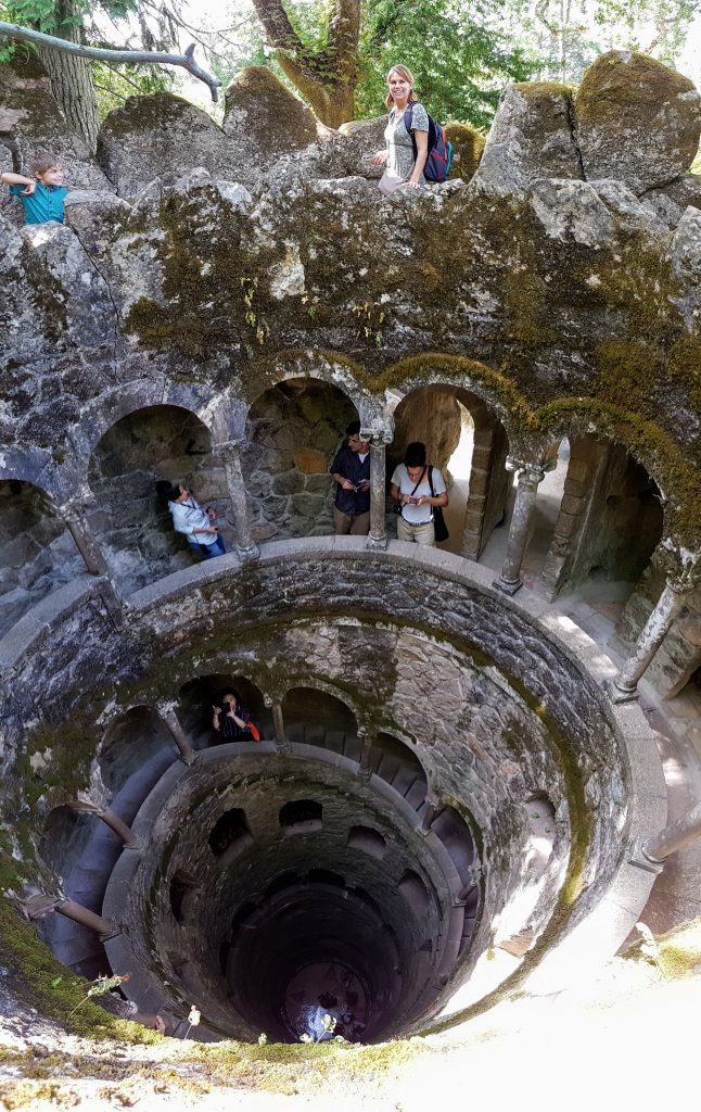 Climbing into the Initiation well at Quinta da Regaleira