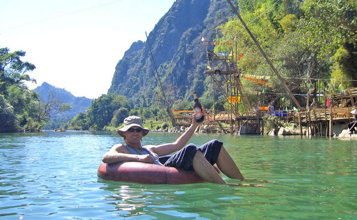 Having a beer while floating down a river in Laos
