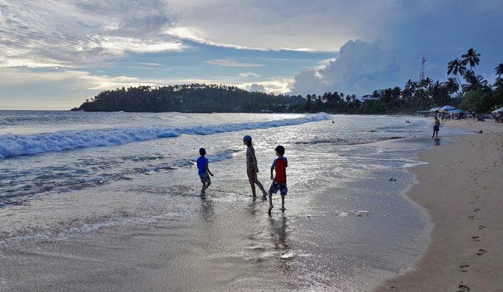 playing on the beach in Mirissa, Sri Lanka